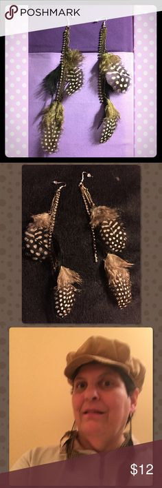 "Brown,White, Black Feathers & Rhinestone Earrings These 7"" length beauties have three feathers on each one. Two that are light brown with white spots and one that's black. There is a 4 1/2"" beautiful cup link chain of diamond chip Rhinestones. Each feather hangs from a curb chain. Ear wires are new 925 Sterling Silver with rubber caps. Feel free to ask me any questions. Thank you for shopping my closet! Jewelry Earrings"