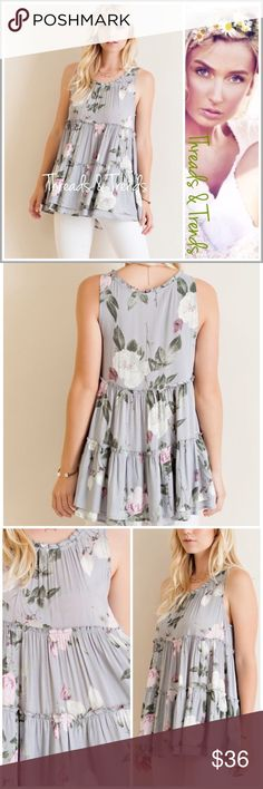 """Floral  Baby Doll  Tank Top Whispy grey baby doll sleeveless blouse. Featuring gorgeous blush & white floral print. Pair with white bottoms or denim. Made of rayon Size S, M, L.                                                       Small Bust 38"""" Length 28""""  Medium Bust 40"""" Length 28""""  Large Bust 42"""" Length 29"""" Patel Threads & Trends Tops"""