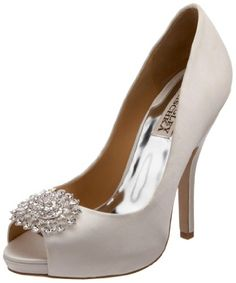"The large crystal-set brooch makes these platform pumps a major statement. The peep toe design is lightly updated with a slim cut 4.5"" heel. Made from diamond white silk. http://www.amazon.com/dp/B004FZ8IDW/?tag=icypnt-20"
