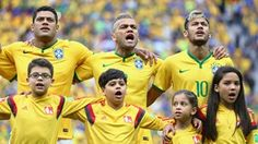 Hulk, Dani Alves and Neymar of Brazil sing the National Anthem