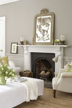 black face and brick interior of fire. beautiful traditional style decor in a neutral color palette living room