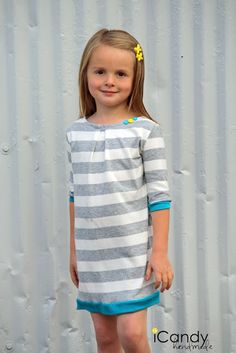 Nice, simple winter dress. Would look great in navy and white stripe with red trim and big buttons