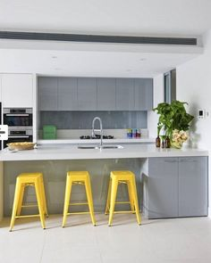 Grey kitchen with that pop of bright gold color me teg grey yellow kitchen, Yellow Kitchen Accents, Gray And White Kitchen, Kitchen Grey, Yellow Accents, Kitchen Living, New Kitchen, Kitchen Decor, Kitchen Stools, Living Room