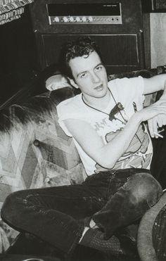 Joe Strummer of The Clash kicking back