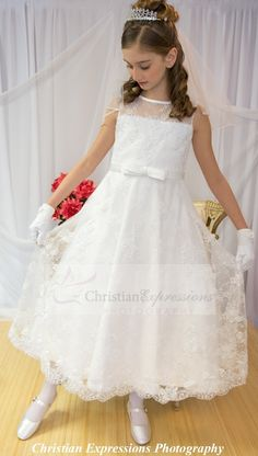 Lace and organza first communion dress in tea length. Available exclusively at Christian Expressions 245 Phenix Ave Cranston, Rhode Island and online: http://www.firstcommunions.com/first-communion-dresses/lace-and-beading-accents-first-communion-dress-style-8011.html