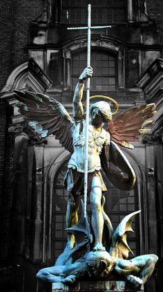 """Victory Over the Devil"" statue at St. Michaelis Church in Hamburg, Germany."