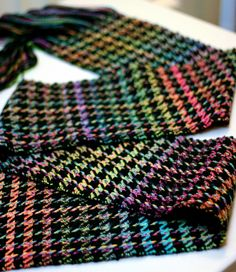 Hand woven variegated houndstooth scarf.