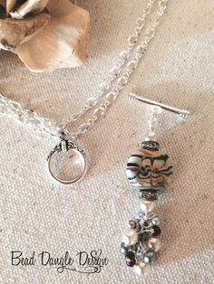 This is such a clever idea. You have the base necklace and just change the charm to suit your outfit.