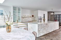 Luxury contemporary marble kitchen brass accessories wood herringbone flooring Contemporary Marble Kitchens, Parisian Kitchen, Neutral Kitchen, Carrara Marble Kitchen, Architects London, Herringbone Wood Floor, Kitchen Room Design, Kitchen Designs, Residential Architect