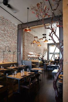 Love all the elements -- the grays, the golds, the tree, the brick wall, the balance of light. AQ Restaurant :: San Francisco #restaurantdesign