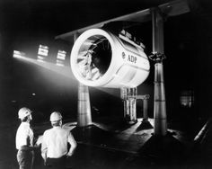 NASA aerospace engineers Pete Zell (left) and Dr. William Clifton Horne (right), project director are shown preparing a laser light sheet for a flow visualization test. The subject of their test is Pratt & Whitney's Advance Ducted Propulsor (ADP) demonstrator engine in the Full-Scale Aerodynamic Complex (NFAC) 40 x 80 foot Wind Tunnel. Shown standing in the nacelle of the ADP is John Girvin, senior test director at NASA Ames Research Center.