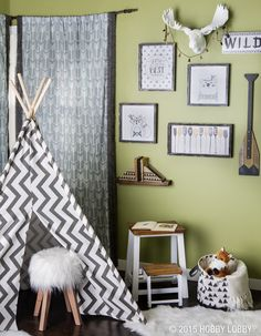 Give your nursery a modern twist with an adorable fabric tee pee and woodsy decor.