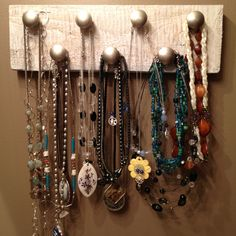 Necklace holder made from painted scrap wood and drawer pulls. 30-minute project!