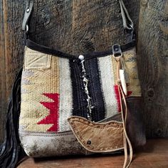 Navajo mini bucket shoulder bag with chaps leather base
