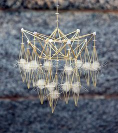 Winter Light collection. Modell B. (Foto Lennart Edvardsson) rye straw, white cards, webs, bleached linen thread, white fabric, tissue paper and white egg shells.