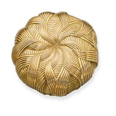 A GOLD 'RUBANS' POWDER COMPACT, BY JEAN SCHLUMBERGER FOR TIFFANY & CO.  The textured gold compact of circular outline with stylised ribbons radiating from the centre opening to reveal a mirror, made in 1959