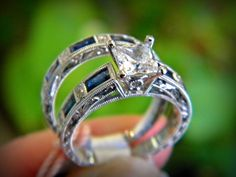Side view of a Kirk Kara engagement ring with sapphires and diamonds set in white gold. You can find this at Diana Jewelers in Liverpool, NY. Right outside of Syracuse!