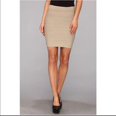 BCBG Max Azria Bandage Skirt Tan mini bandage skirt from BCBG. Only worn once, in good condition. BCBGMaxAzria Skirts Mini