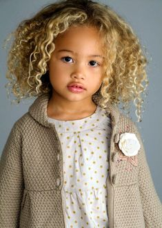 Biracial cute. Love the blonde hair against the brown skin.