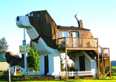 Dog Bark Park Inn in Cottonwood Idaho,USA  The hotel is a two storey building with a two bedroom B, featuring dog shaped contents, and even the bathroom is shaped like a fire hydrant. The hotel is owned and operated by husband and wife artists, Dennis and Frances Sullivan, who made their living by carving 60 different breeds and poses of dogs, and other themed carvings.    Source: Weirdly Odd