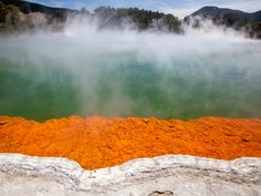 """Soak your feet in the hot springs of Rotorua, a New Zealand city known for its geysers, thermal springs, and bubbling mud pools. It's nicknamed the """"Sulphur City"""", and visitors can also partake in water sports in the region's many lakes."""
