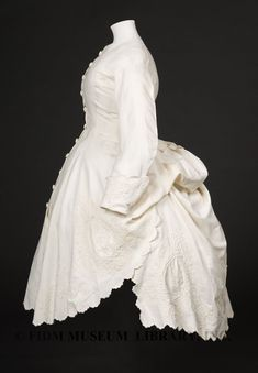 """Polonaise bodice  In 1872, fashion periodicals such as Godey's Lady's Book, Peterson's Magazine and Harper's Bazaar were filled with references to various styles of the polonaise dress. Whether a princess, vest, Russian or dolman polonaise, the common characteristic was a gathered and bunched puff of fabric at the back. Created through interior ties that pulled the fabric upwards, the polonaise was essentially a fitted overdress worn over a skirt of matching or contrasting fabric."""