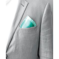 Clean platinum and turquoise. Groom wedding apparel.