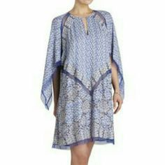 BCBGMAXAZRIA  Bardot ALine Dress A printed gently drapped a line silhouettes with  alluring chiffon inserts round neckline with keyhole detail. Long cape sleeves.. pristine condition.. BCBGMaxAzria Dresses