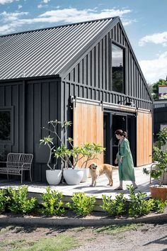 This modern barn style house exterior with timber barn doors was inspired by Nor.This modern barn style house exterior with timber barn doors was inspired by Nordic Noir homes. The house was built in just 10 weeks Metal Building Homes, Building A House, Metal Homes, Exterior Wall Cladding, Exterior Doors, Exterior Paint, Modern Barn House, Timber House, Wooden House
