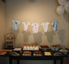Cute baby shower ideas - onesie banner and napkins folded into diapers.