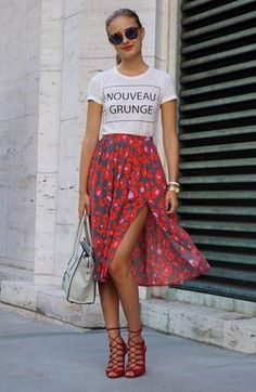 Casual nouveau grunge street style. Love the casual tee teamed with floral skirt and lace up stilettos.