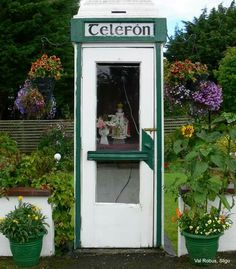Direct line to heaven .  Child of Prague in telephone box, Co Roscommon
