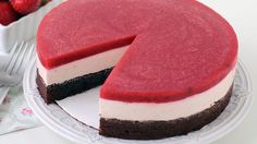 Layered cake with a brownie base, topped with creamy strawberry cheesecake mousse and a strawberry gelée.