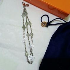 NWT Tory Burch multi strand logo bracelet Beautiful Tory Burch multi strand logo bracelet in silver color.  7 inches long. Clasp closure.  New and Authentic!! Tory Burch Accessories