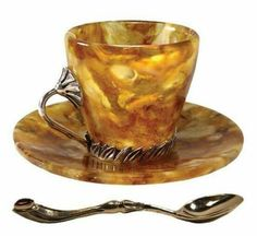 An antique Russian amber tea cup and saucer set. I also like the shape of the spoon. I would think quite an eloquent feeling when having tea at this setting! Cup And Saucer Set, Tea Cup Saucer, Coffee Cups, Tea Cups, Vintage Tee, Cuppa Tea, Teapots And Cups, My Cup Of Tea, Tea Service