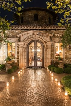 The front entrance lit by candles going up the walkway to the double doors of Villa Siena | villasiena.cc