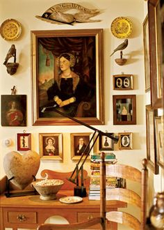 Live with your Collections Your collections don't have to match as long as they have a similar theme. This montage of and folk art portraits and silhouettes turns blank wall space into a gallery.