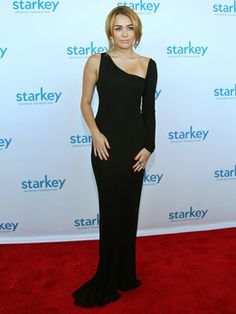 2011 Back to her favorite black, Miley looked totally sophisticated in this classic gown. We love that she accessorized the grown-up style with hot pink polish!