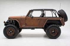"""Ryan and Terra Hagel from RCH Designs in Huntington Beach, CA. It has been refreshed with this new """"Patina"""" or rust finish. Truly one of a kind, this Jeepster is outfitted with a ProRock 60 front and Rear along with a custom suspension set-up by way of Off Road Evolution."""""""