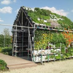 Eathouse - A house and garden to eat, touch, smell, taste, seed, weed, and harvest!     Eathouse consists of a modular system of plain plastic crates. These crates are used in the agricultural industry to harvest, transport and exhibit fruit and vegetables in combination with a scaffold system. With this system vertical green becomes accessible for everyone; you can make your own vegetable garden on the wall of your balcony or on the roof of your garden shed!  www.vegoutwithlinda.com