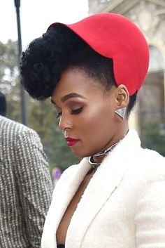 Love the red hat and red lipstick, matching the dark skin perfectly. Janelle Monae