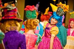 The munchkins are dressed in all sorts of colors! Children's Theatre Company's 2011-2012 production of The Wizard of Oz. Photo by Dan Norman.