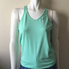 """Nike Dri-Fit Tank Top Nike Dri-Fit Tank Top comes in a mint green with an elastic waistband and mesh razor back. Size: M Length: 24"""" In excellent condition. Nike Tops Tank Tops"""