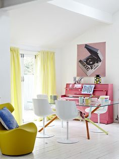 keep the piano near the doors, add in front of it a different function in the room and create a cozy nook for the seating places on the wall against the doors