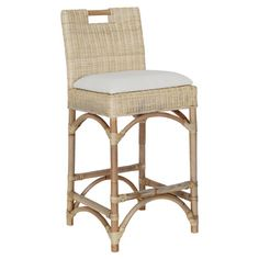 Bring island-inspired style to your kitchen island or pub table with this lovely counter stool, showcasing a woven rattan design and a cushioned seat.  ...