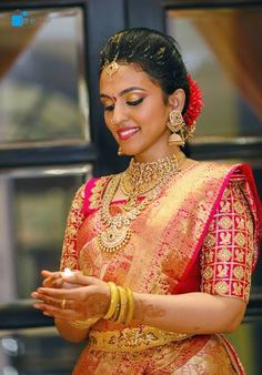 South Indian bride. Gold Indian bridal jewelry.Temple jewelry. Jhumkis.Red silk kanchipuram sari.braid with fresh jasmine flowers. Tamil bride. Telugu bride. Kannada bride. Hindu bride. Malayalee bride.Kerala bride.South Indian wedding.