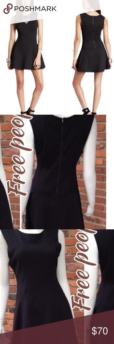 """Free People black dress DESCRIPTION Less is more in this Cha Cha ponte mini dress from Free People with a fitted silhouette and a lightly flared skater skirt. Size medium Free People ponte mini dress. Approx. 31 3/4""""L from shoulder to hem. Round neckline. Sleeveless; wide shoulder coverage. Exposed back zip. Angled front seams nip in dress at waist. Lightly flared skirt with round hem Free People Dresses"""