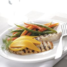 """Grilled Tilapia with Mango Recipe -""""This is a different twist on tilapia that I created for my wife. She enjoyed the combination of mango with the Parmesan. There's nothing like eating this out on the deck with a cold glass of iced tea."""" Gregg May - Columbus, OH"""
