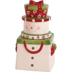 """Bring a touch of holiday delight to your tabletop with the charming Snowman Swirl Cookie Jar.   Product: Cookie jar Construction Material: Dolomite Color: Green, red and white Dimensions: 10.92"""" H x 6.48"""" W x 5.64"""" D"""