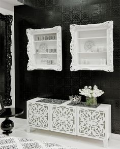 Wall shelves framed with white ornate picture frames.